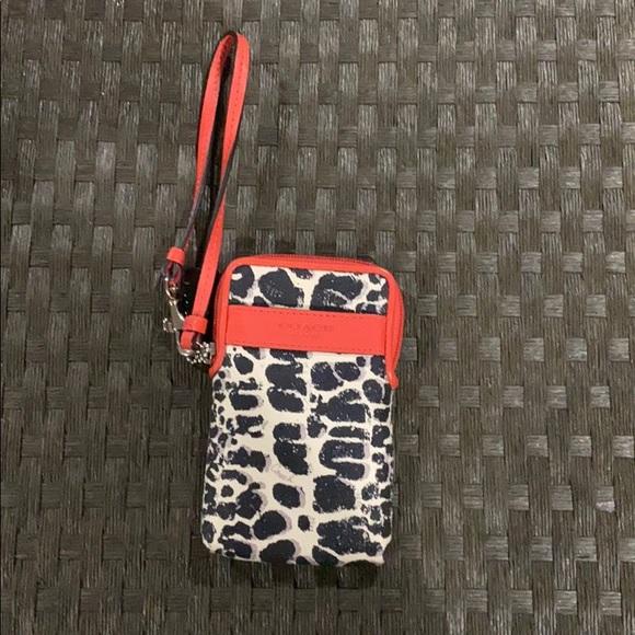 Coach Handbags - Coach leopard zip around wristlet